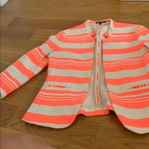 A neon pink and white blazer